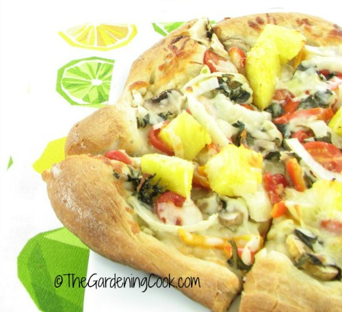 vegetarian pizza with pineapple and fresh basil
