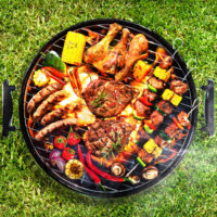 BBQ grill loaded with food for entertaining.