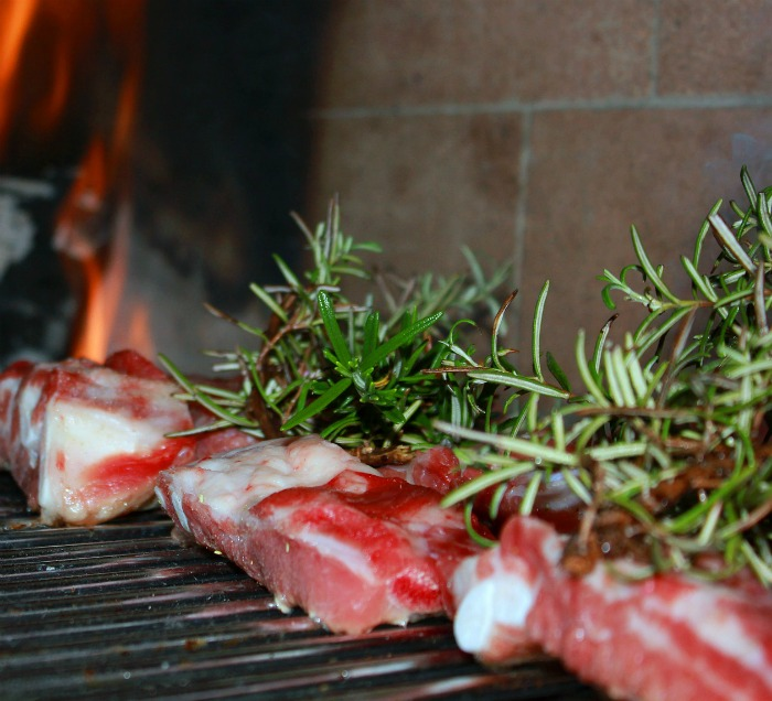 Fresh rosemary on grilled meat