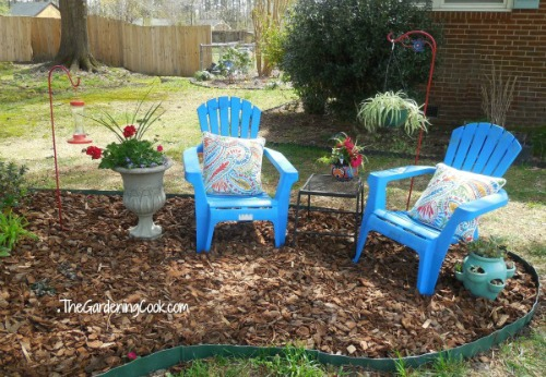 To create curb appeal add a pretty seating area in the Front yard.