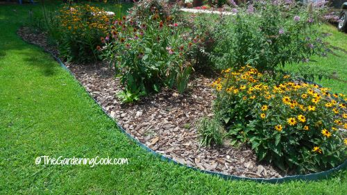 Use curved edges to add softness to a cottage garden