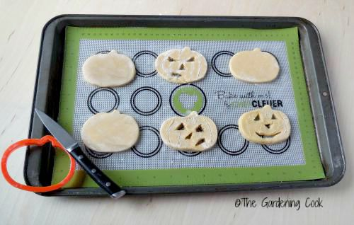Halloween pumpkin cookies on silicone mat