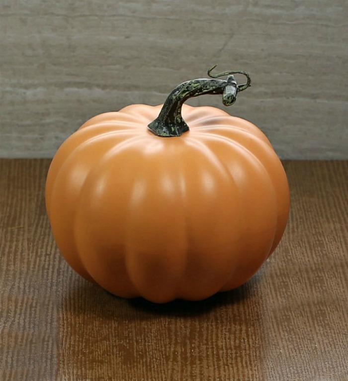 Faux pumpkin with a long stem,