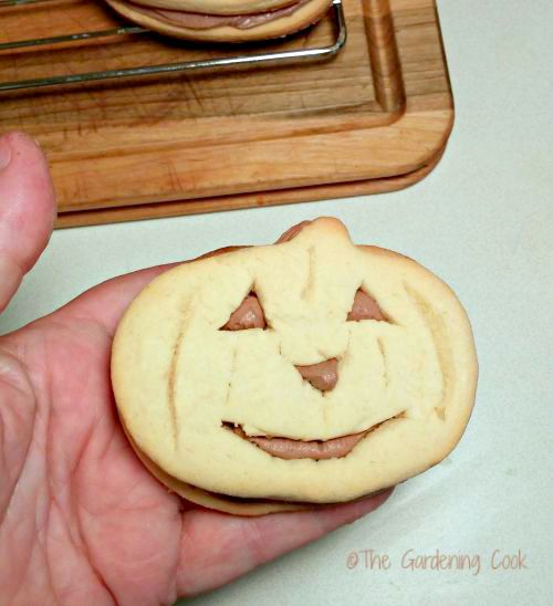 Halloween Pumpkin cookie with frosting inside.