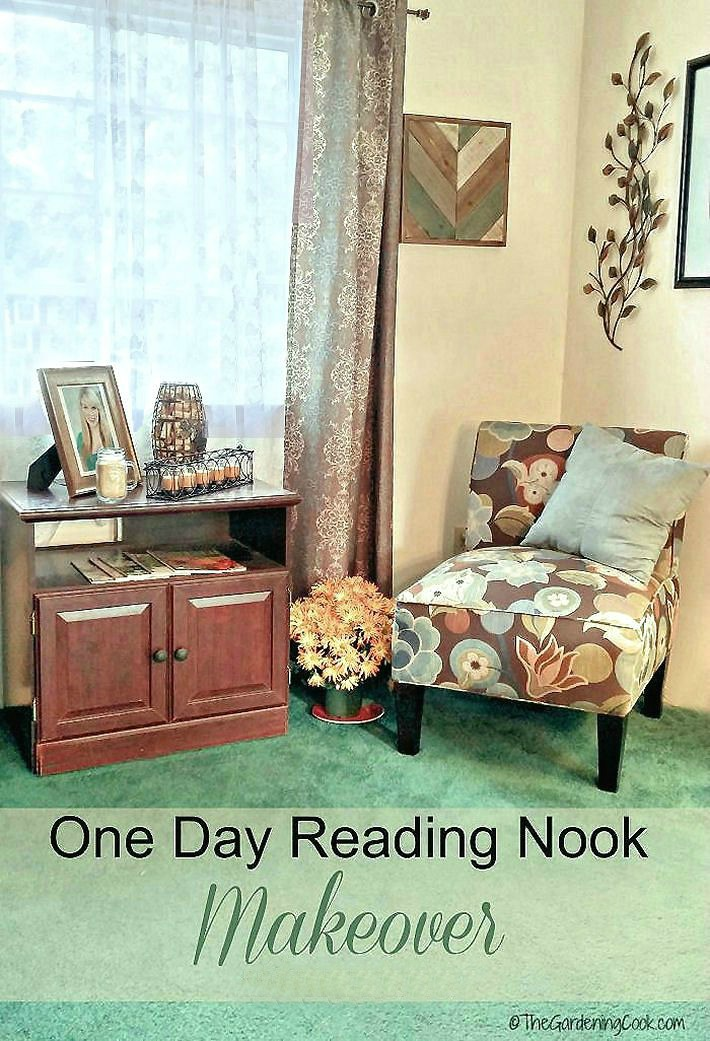 Chair with a cushion, plant and table with pictures and candles. Text overlay reading One Day Reading Nook Makeover.