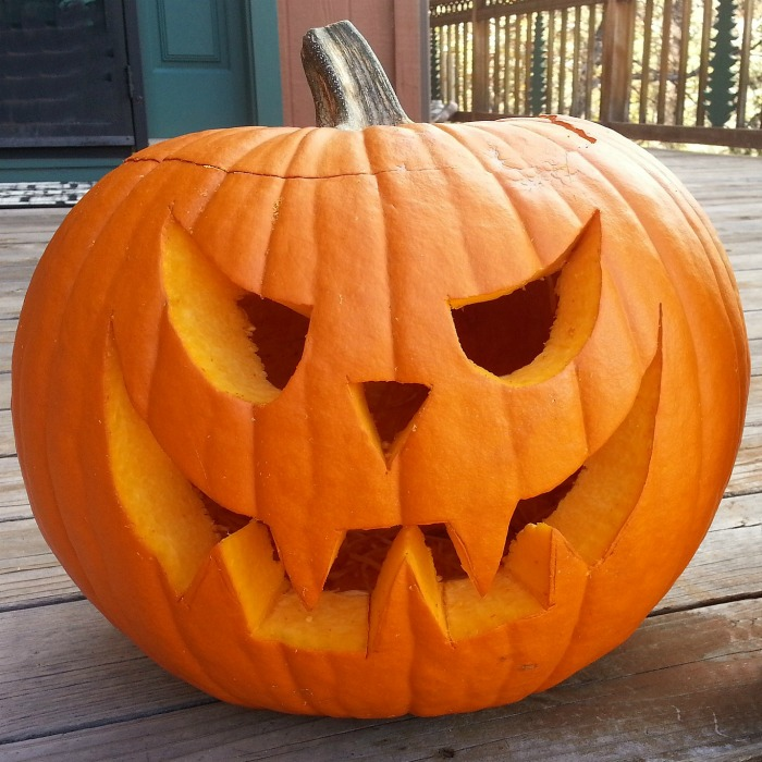 Simple carved pumpkin on a porch