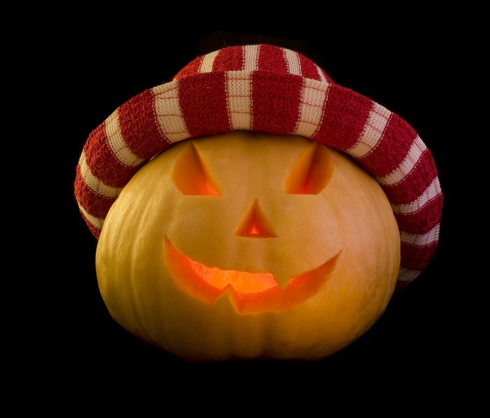 Pumpkin face with a red and white hat