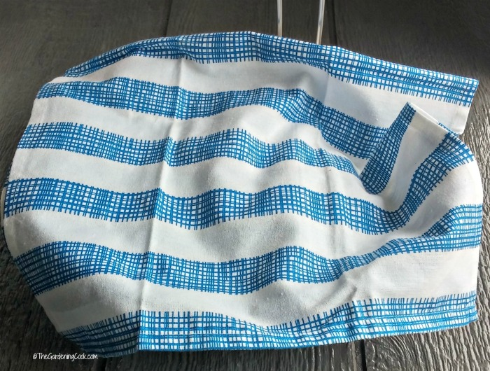 Line the basket with a blue tea towel