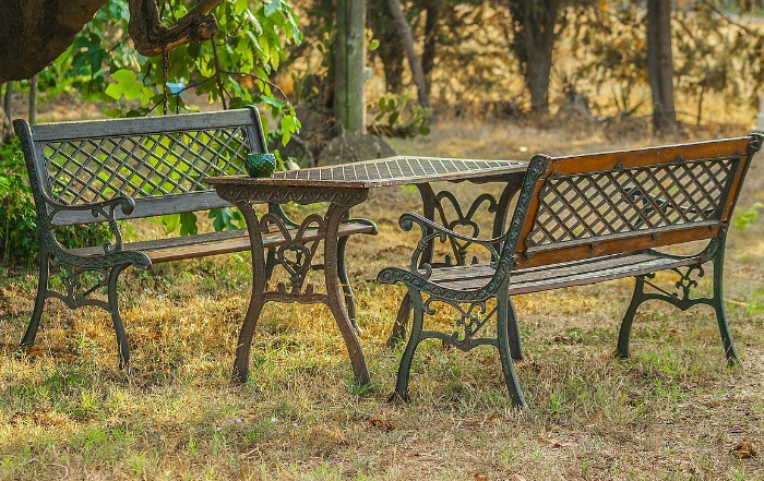 Matching garden benches make an eating area