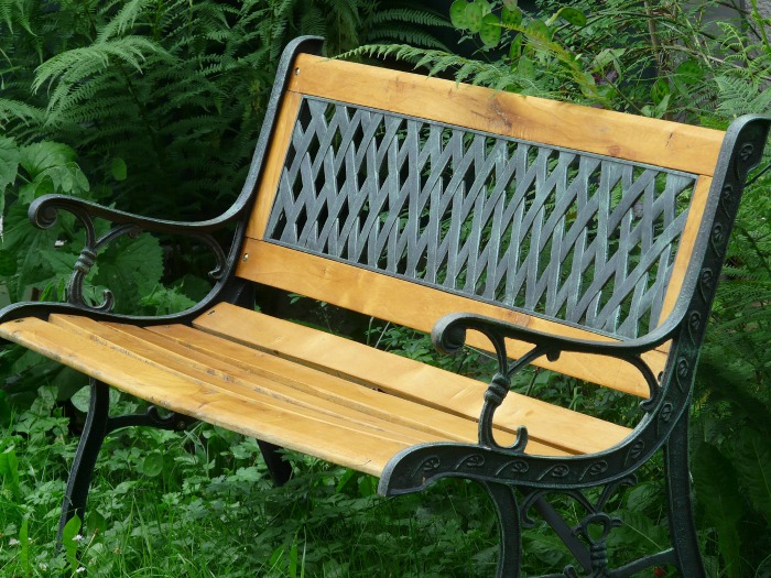 Metal backed garden bench