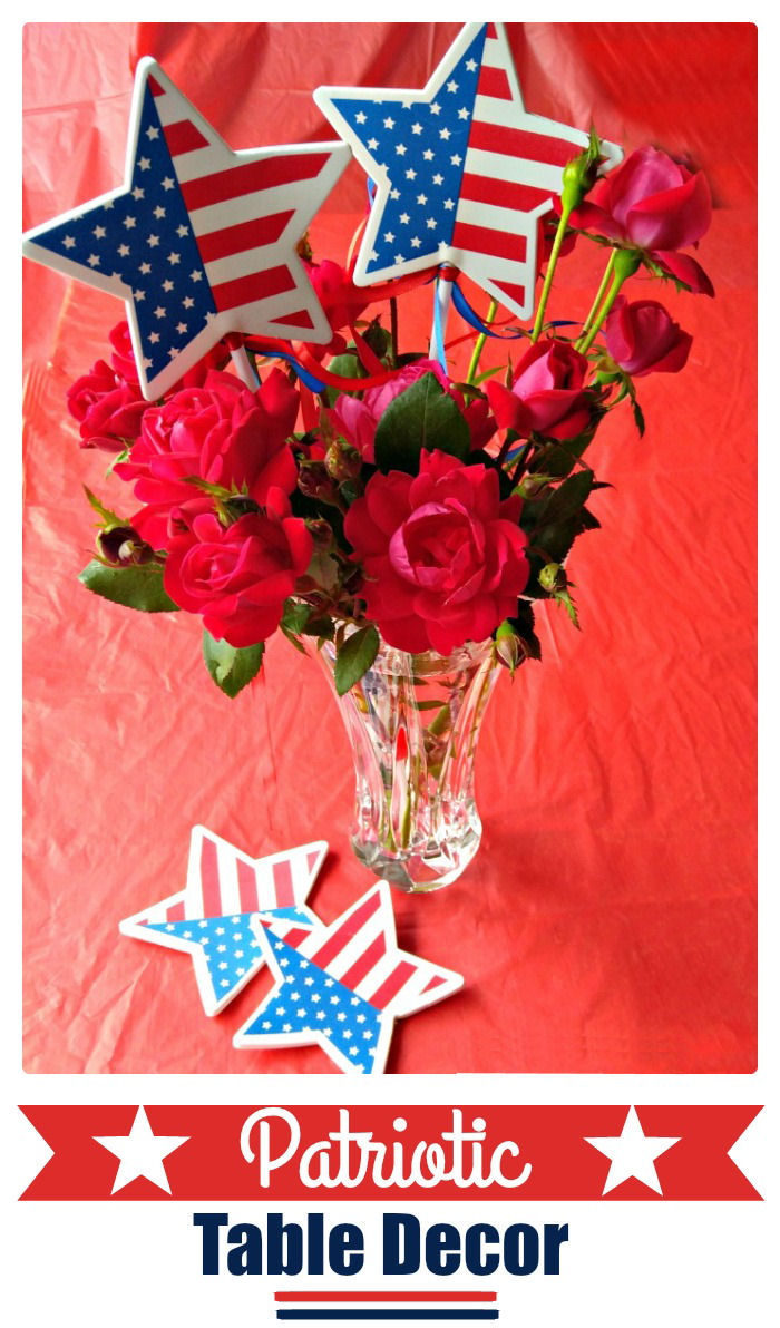 Flowers in a vase with flag stars and words reading Patriotic Table Decor.