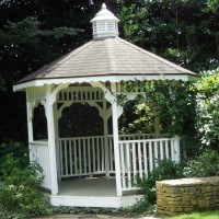 This white gazebo is a perfect place to sit and admire the white garden in Raleigh