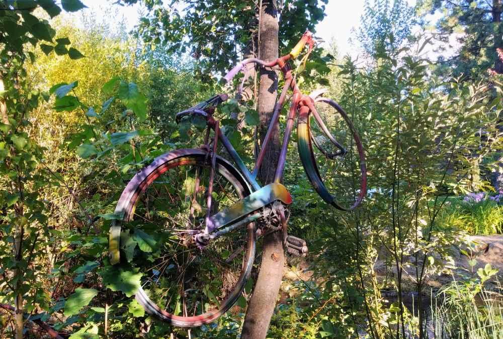 Bicycle in the air inn a garden.