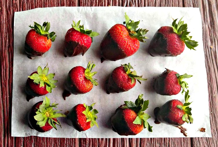 Place chocolate dipped strawberries on Parchment paper