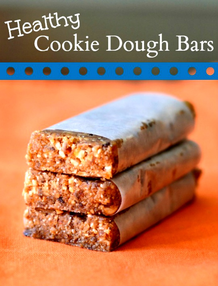 Healthy cookie dough bars wrapped in parchment paper.