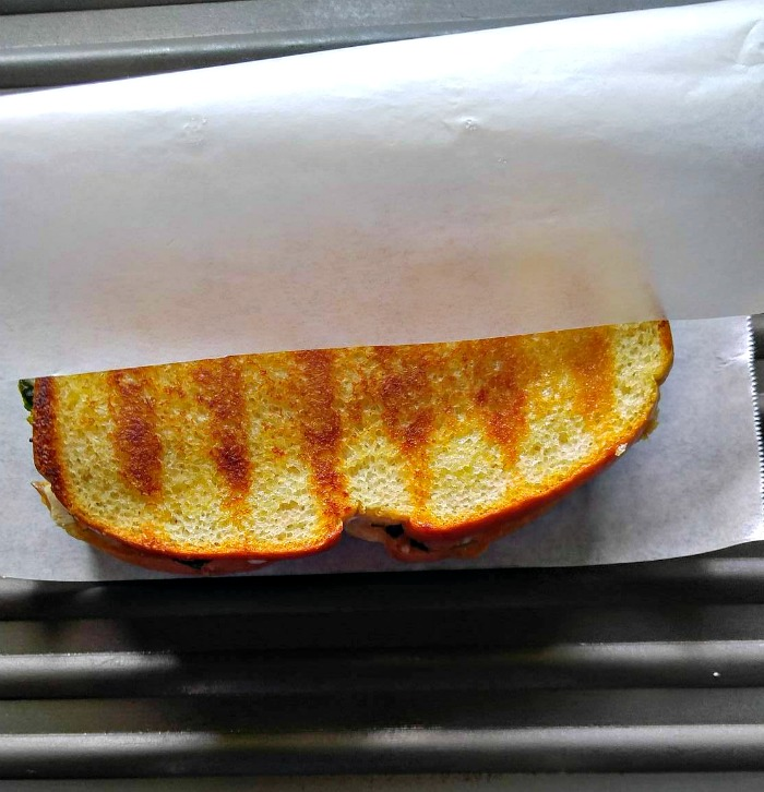 wrap sandwiches in parchment paper on panini plates or grill pans for easy clean up