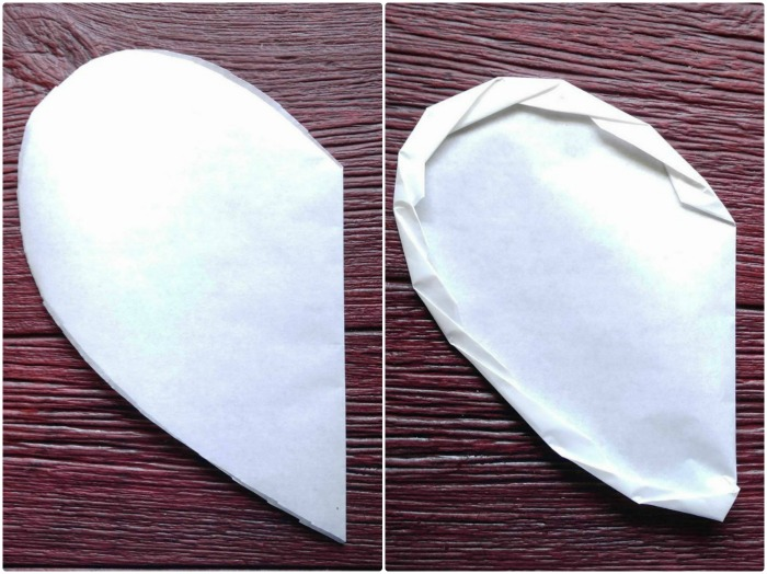 Making a heart shaped parchment paper parcel.