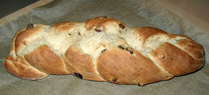 Make your braided bread on a piece of parchment paper and then transfer to a baking sheet.