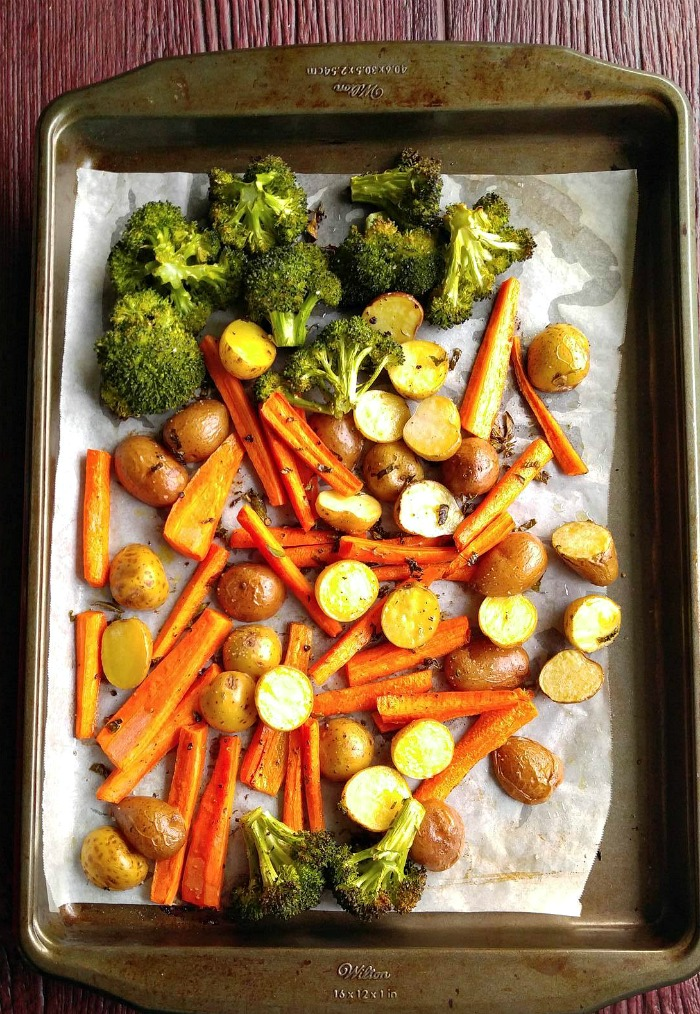 Line baking sheets with parchment paper to roast vegetables