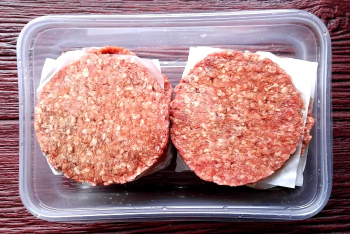 Use cut pieces of parchment paper between burgers to make then easier to separate later.