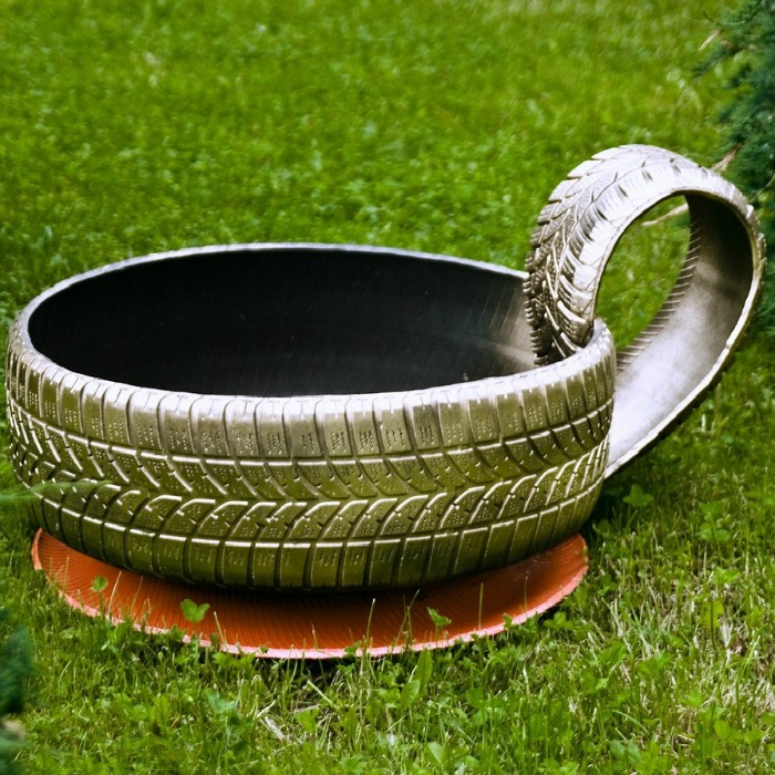 Recycle an old tire by painting it and making it into a tea cup.