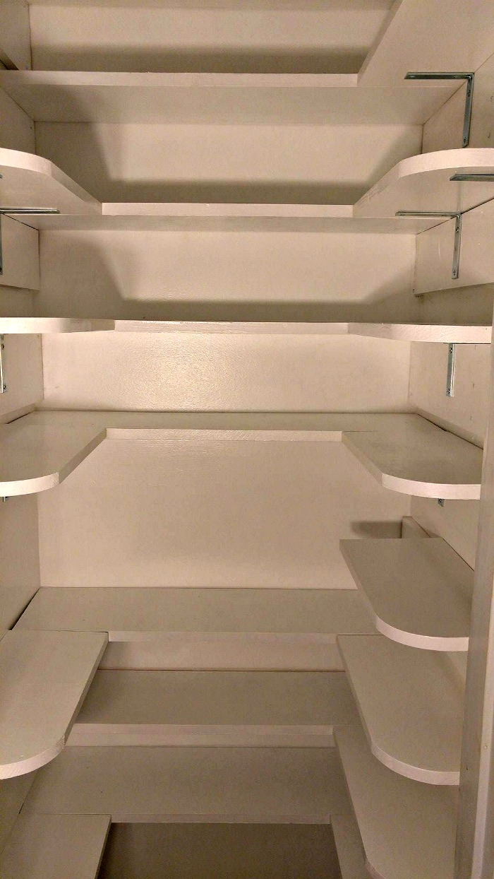 The pantry shelving is competed