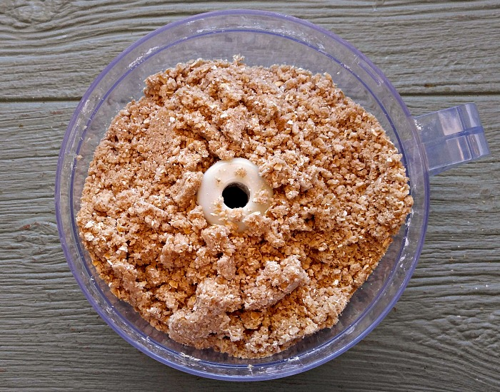 Add the butter and dry ingredients in a food processor and pulse till crumbly
