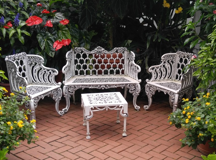 White seating araa in the conservatory at Biltmore Estates