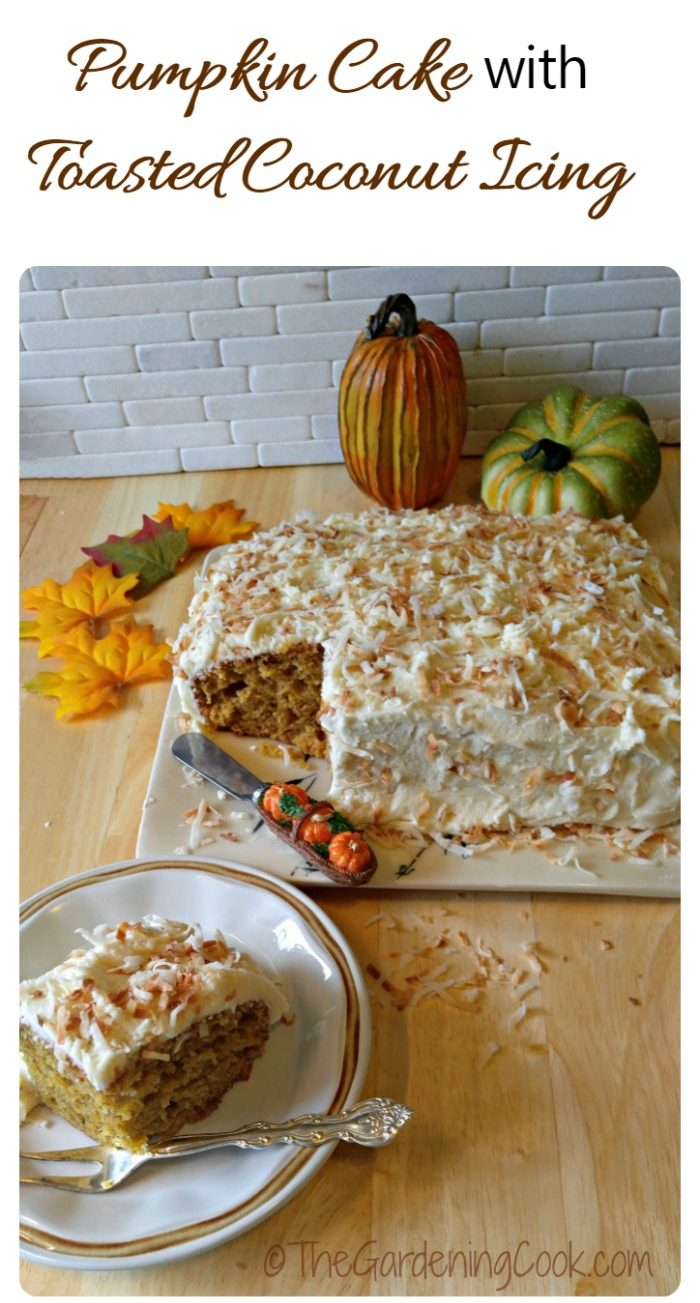 Frosted pumpkin cake and piece of cake near some leaves and faux pumpkins.