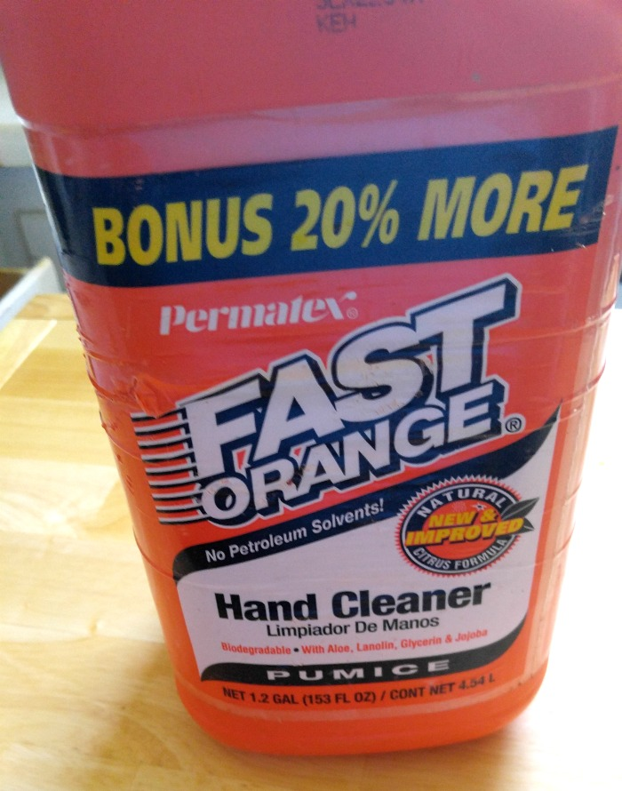 Fast orange hand cleaner cleans the rim of the dry erase board.