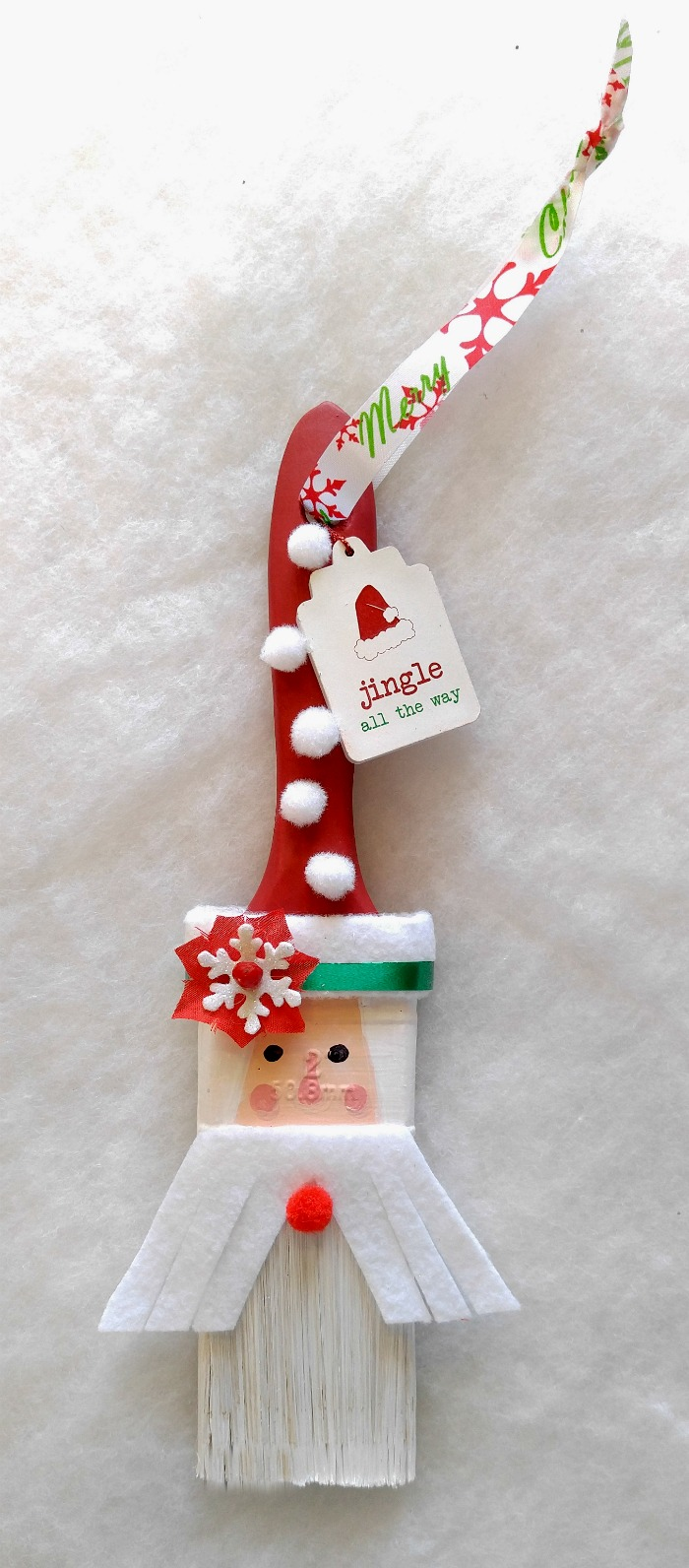 This Santa Claus Paintbrush decoration is whimsical and fun to make and will look cute on a Christmas tree or as a wall hanging.