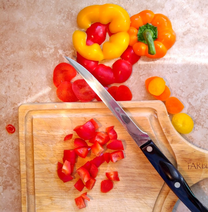 Chop the bottom and top of the peppers