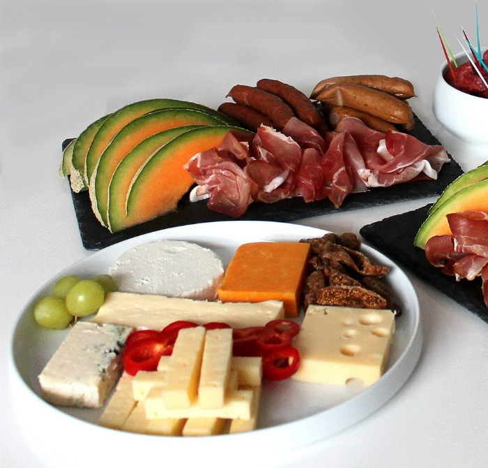 antipasto platters with cold meats and cheese.