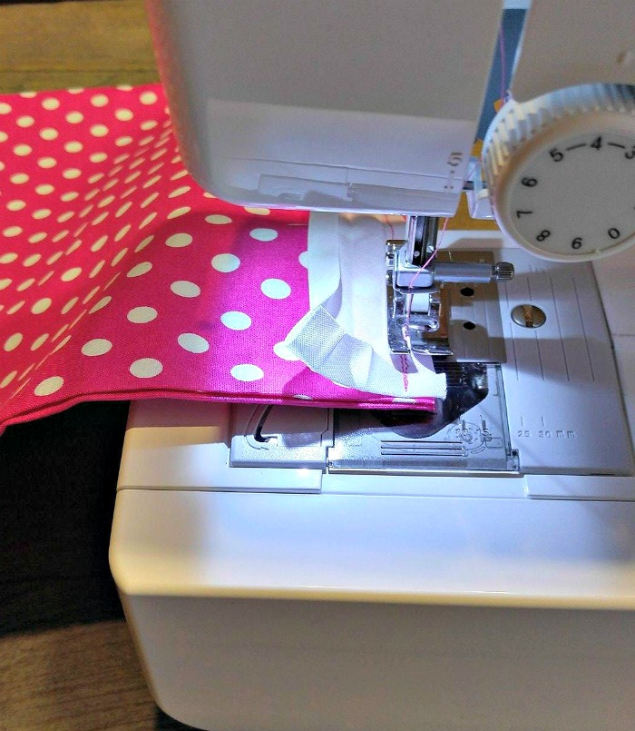 Stitching bias tape in place ion a sewing machine.