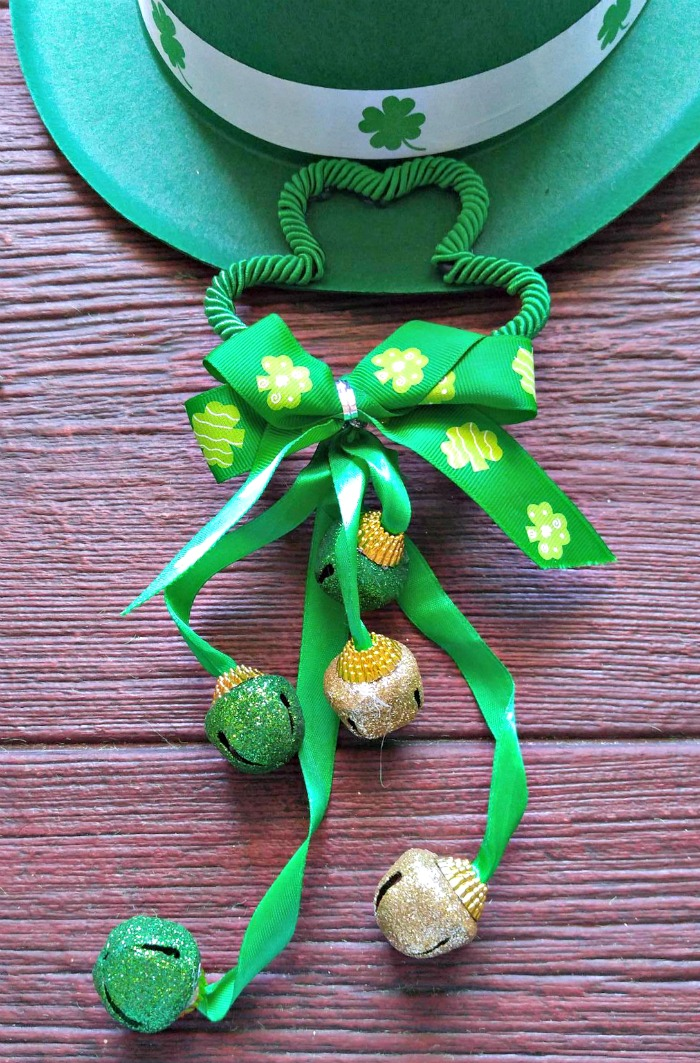 Leprechaun hat with shamrock and bells.