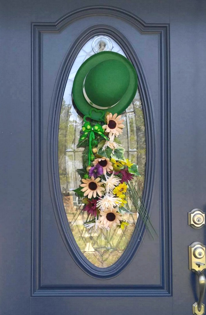 St. Patrick's Day Door Swag with leprechaun hat and silk flowers.