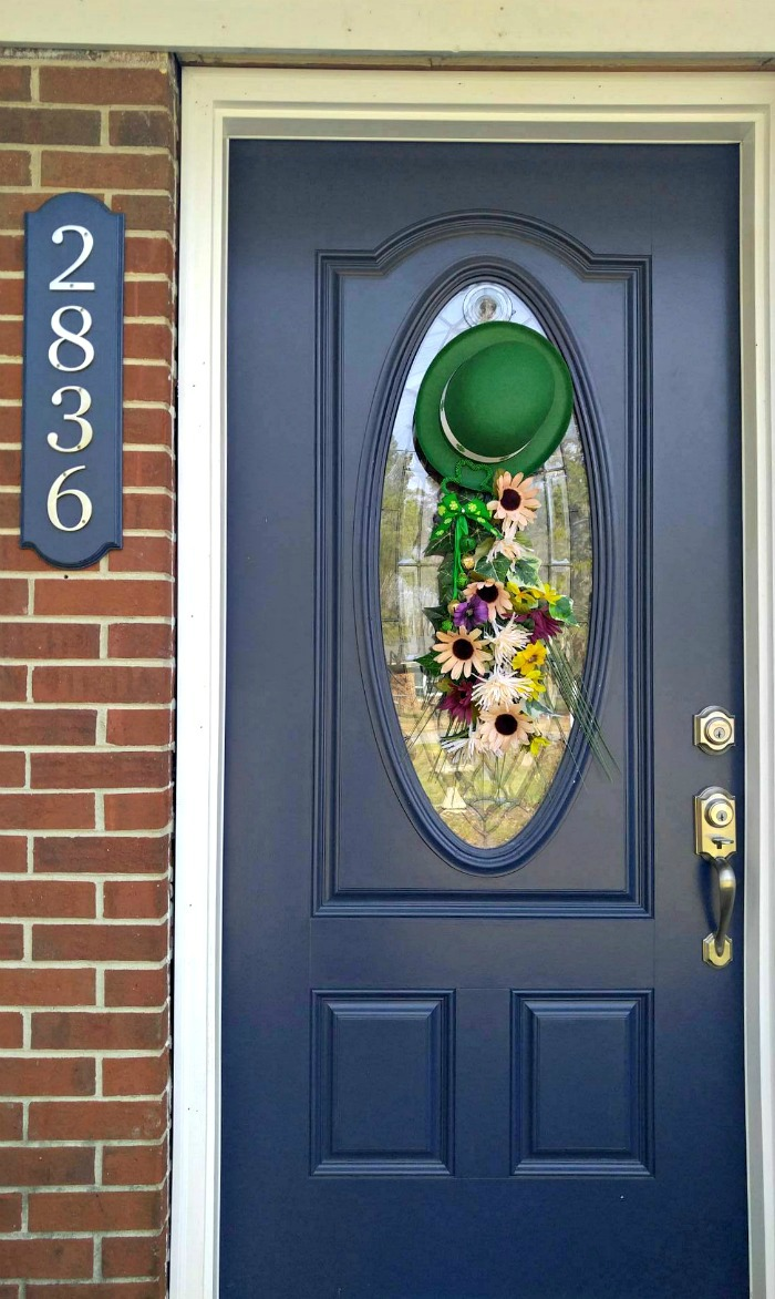 St. Patrick's Day Door Swag on a blue door of a brick house with numbers 2836.