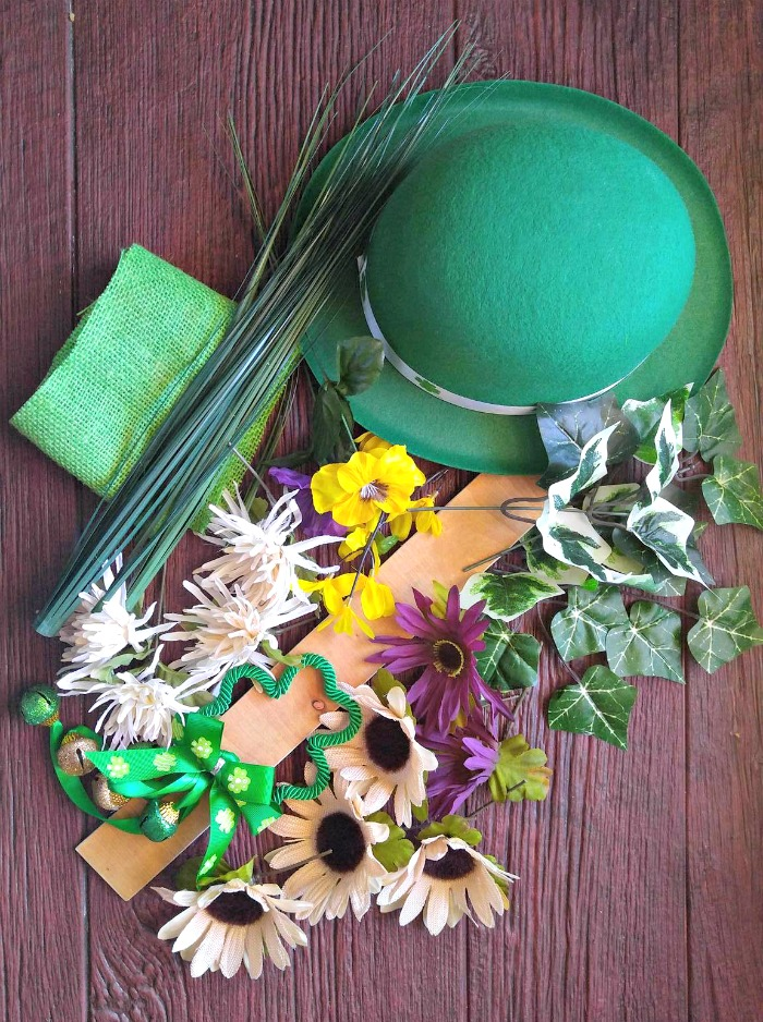 Leprechaun hat, flowers, shamrocks, leaves and plywood.