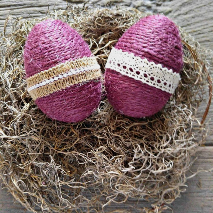 Burgundy rope wrapped eggs with burlap ribbon