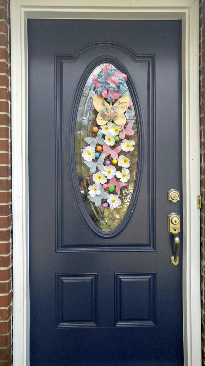 Easter Grapevine Door Swag on a blue entry door
