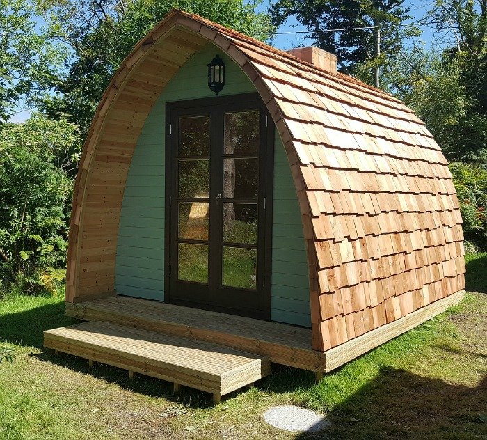 Garden sheds add a whimsical touch to a back yard for Round garden buildings