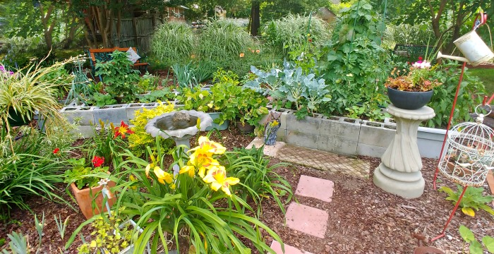 Rasied bed vegetable garden in a flower garden