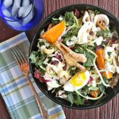 Enjoy this chicken-sunflower-kale-salad with a glass of seltzer water