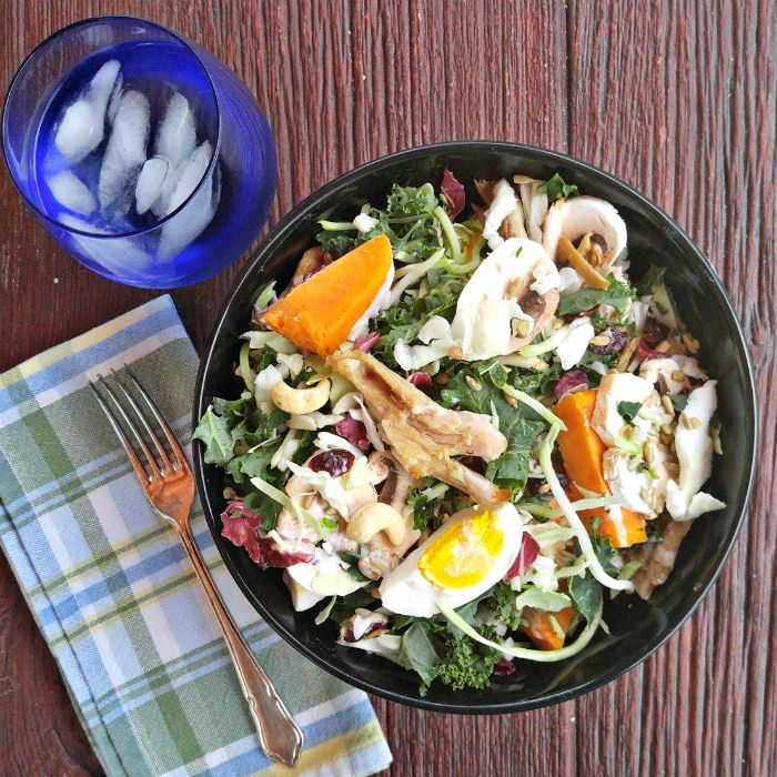 Yams, hard boiled eggs and cashews add a lot to the sunflower kale salad