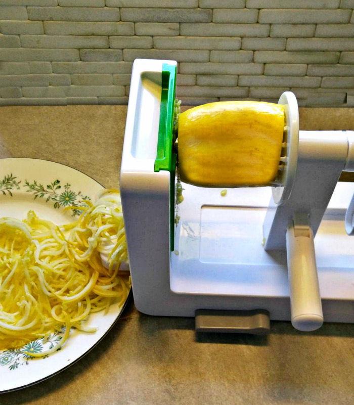 Spiralizing yellow zucchini into noodles