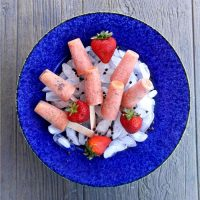Bowl of strawberry chocolate pops on ice