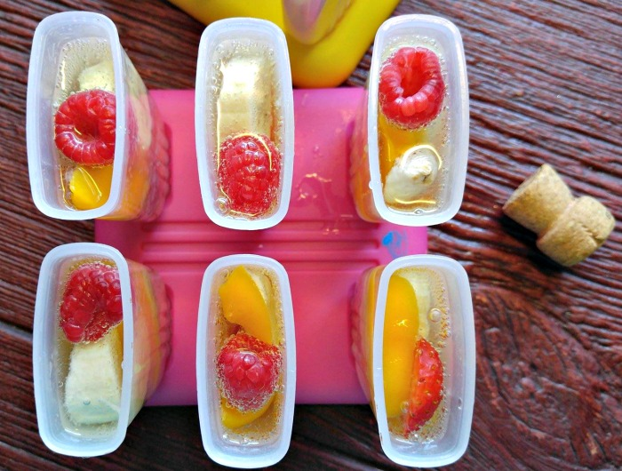 Add champagne over fruit in the popsicle molds