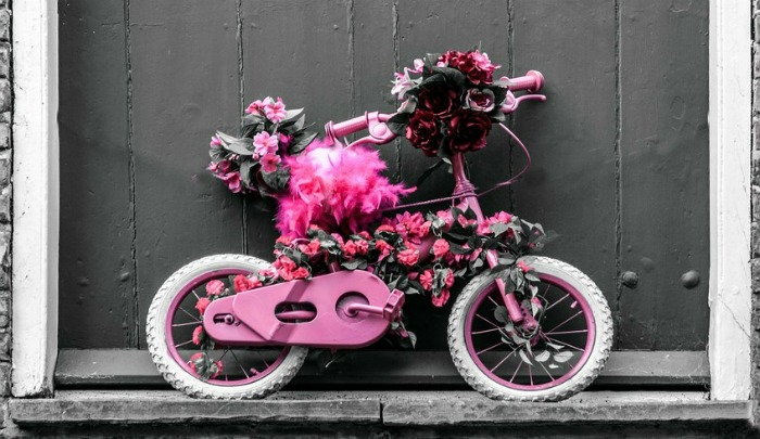 Pink and white child's bicycle planter
