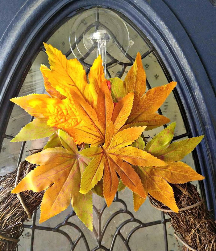 Autumn leaves above the wreath