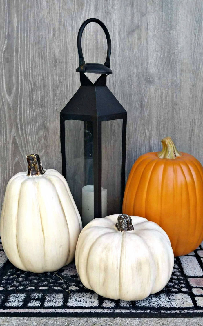 Black lantern and pumpkins